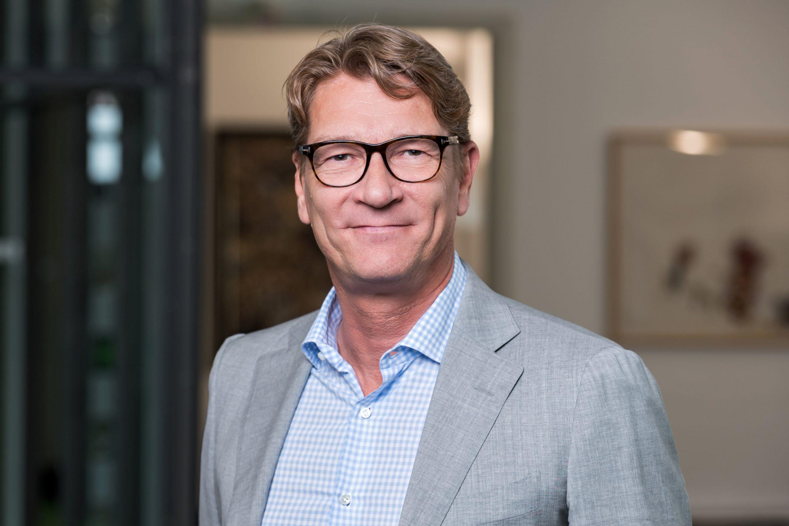Managing Director der TMS Tim Kehlenbeck lächelt